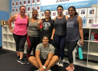 Burn Bootcamp McKinney members with trainer