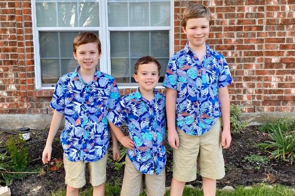 Three boys first day of school