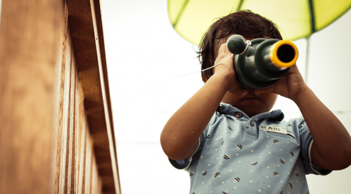 toddler looking through telescope