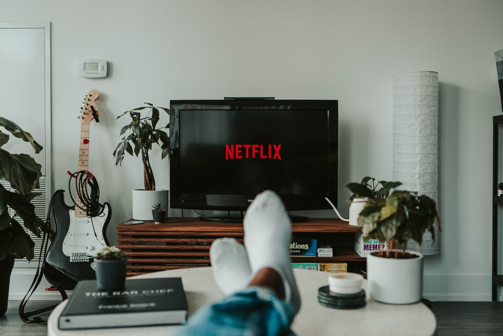 Watching binge-worthy shows on Netflix on the couch