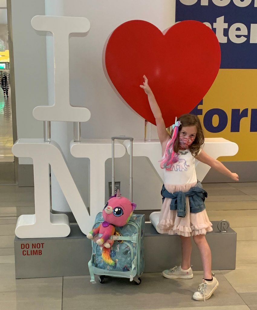 Posing in front of an I love New York sign at LaGuardia