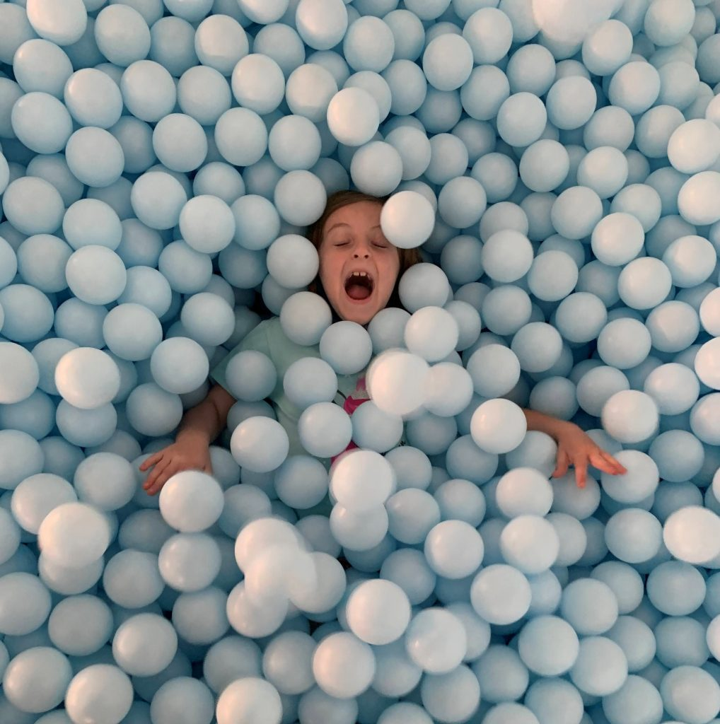Playing in the Ball Pit at The Color Factory in New York