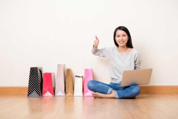 Top 13 tips for buying and selling on Facebook Marketplace. Collin County Moms. Woman enjoying shopping.