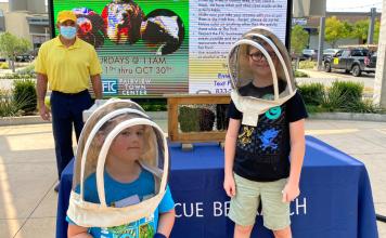 kids wearing beekeeping hats at Critter Club presentation